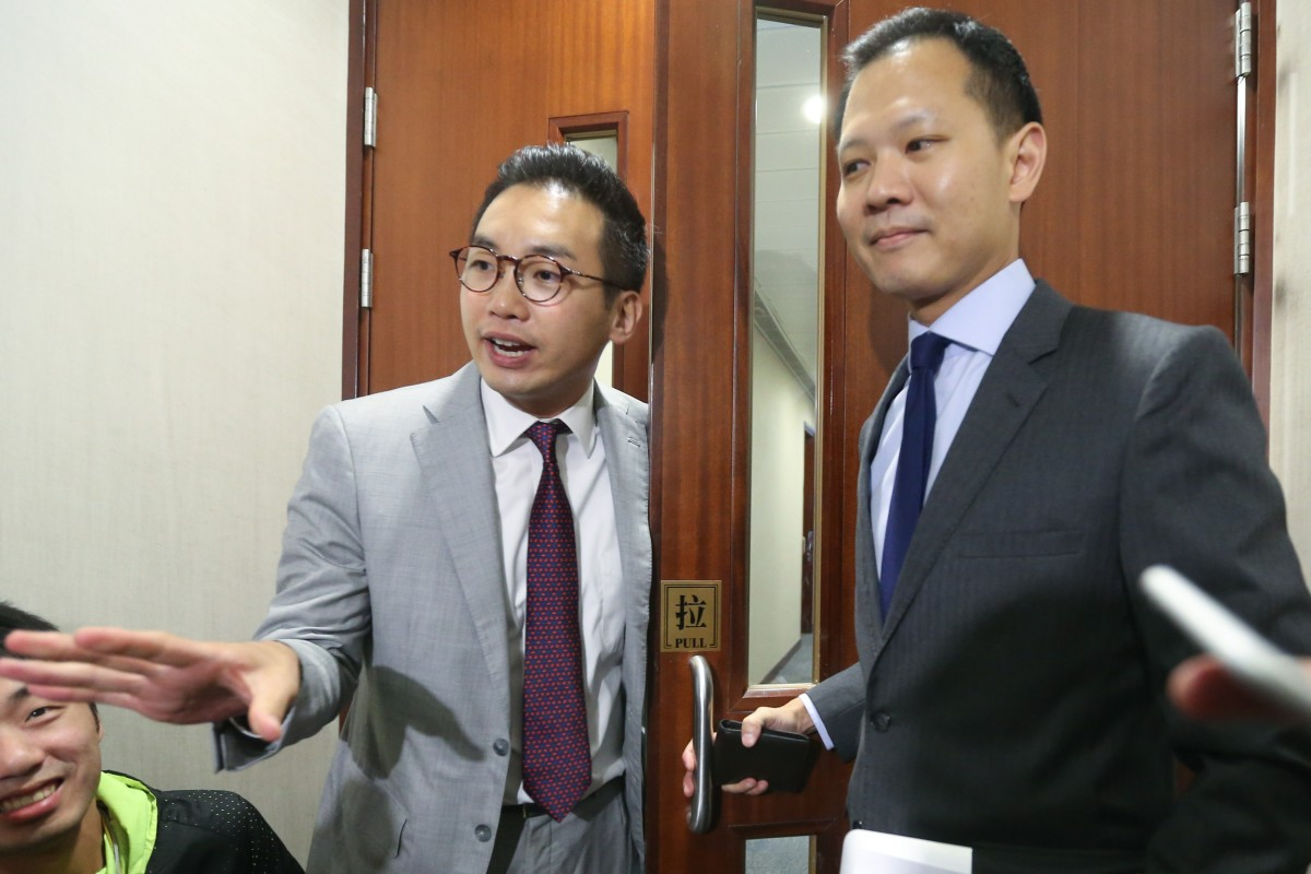 Hong Kong opposition lawmakers promise not to 'bad-mouth