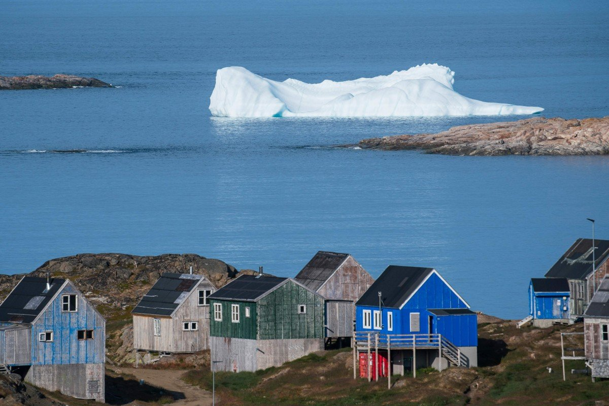 Icebergs float behind the town of Kulusuk in Greenland. Photo: AFP