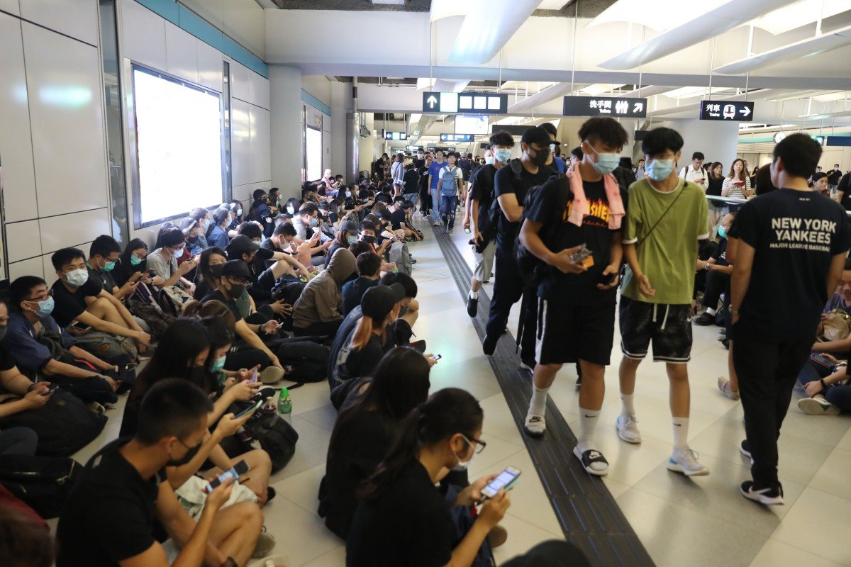 Chaos at MTR station in Hong Kong as protesters confront police while marking one-month anniversary of Yuen...
