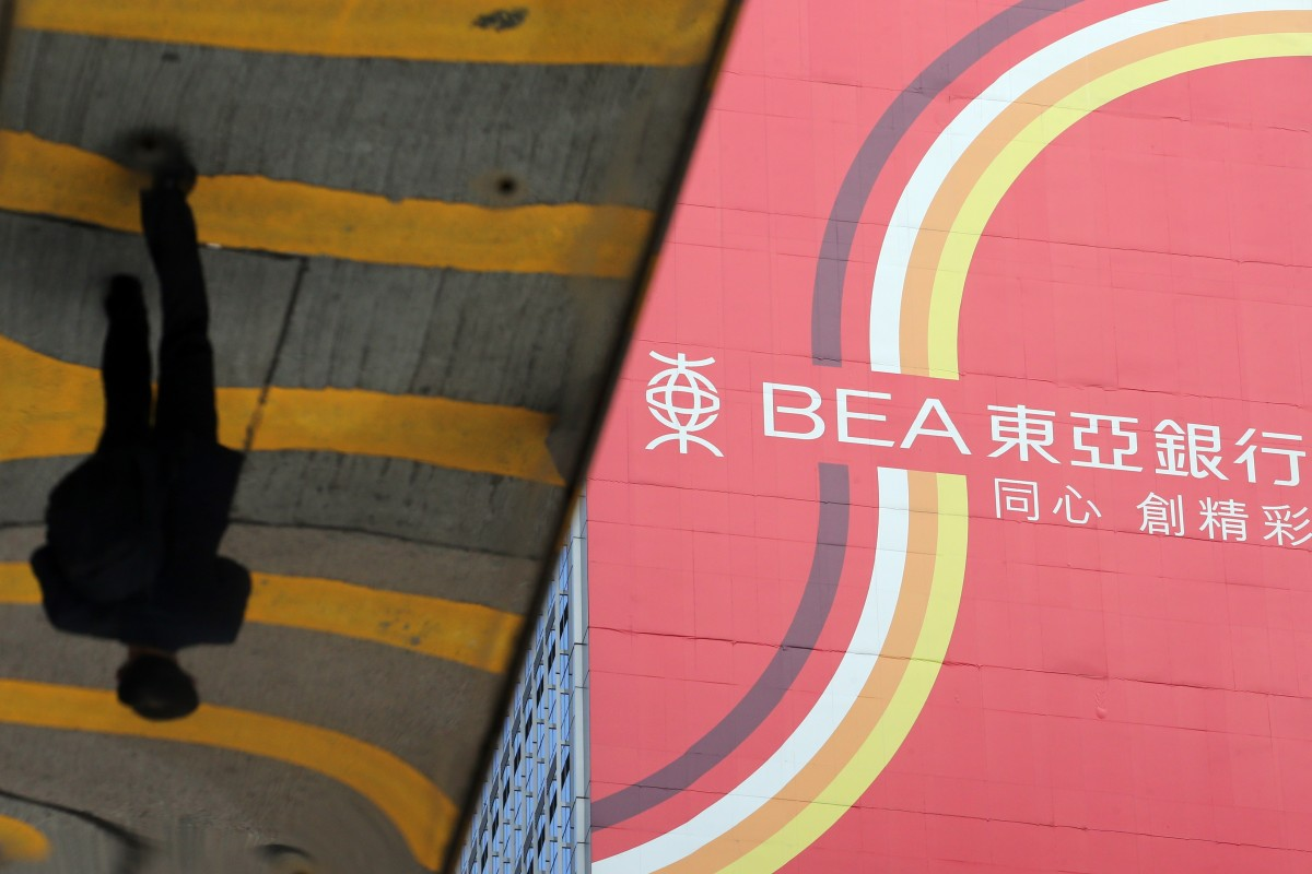 Protests could hammer Hong Kong's economy, Bank of East Asia warns, as its profit falls 75 per cent in...