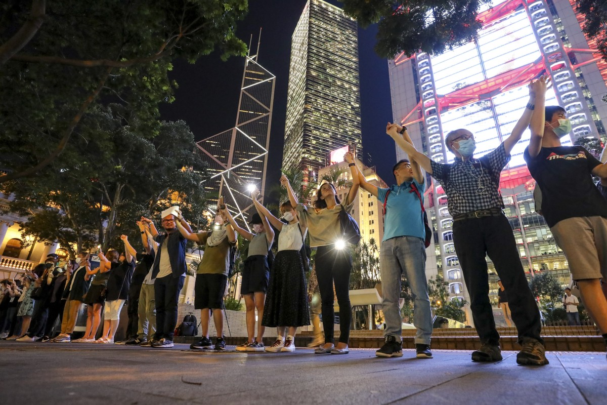 Demonstrators offer sparkling visions of unity as human chains encircle city in 'Hong Kong Way'
