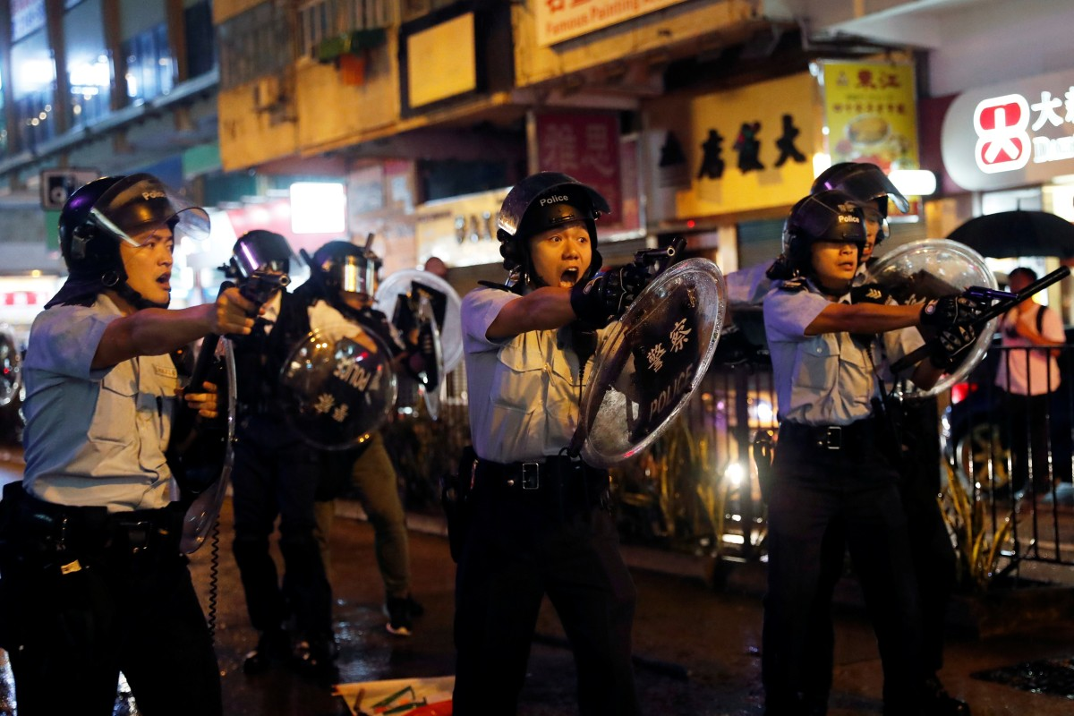Police officer fires gun, water cannon used for first time on protesters in Hong Kong