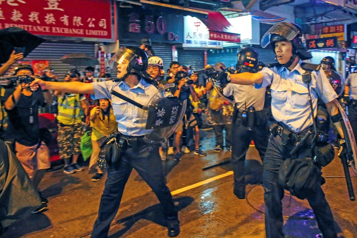 Hong Kong police officer fired warning shot in air because he felt 'life was threatened' by protesters...