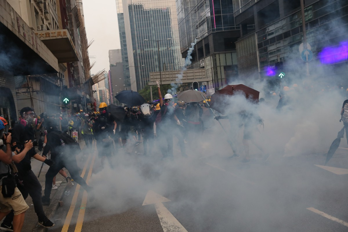 Singapore doesn't profit from Hong Kong chaos, says minister