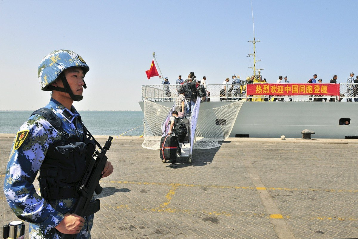 A soldier of the People's Liberation Army stands guard as Chinese citizens board a navy ship in Aden in 2015. Photo: Reuters
