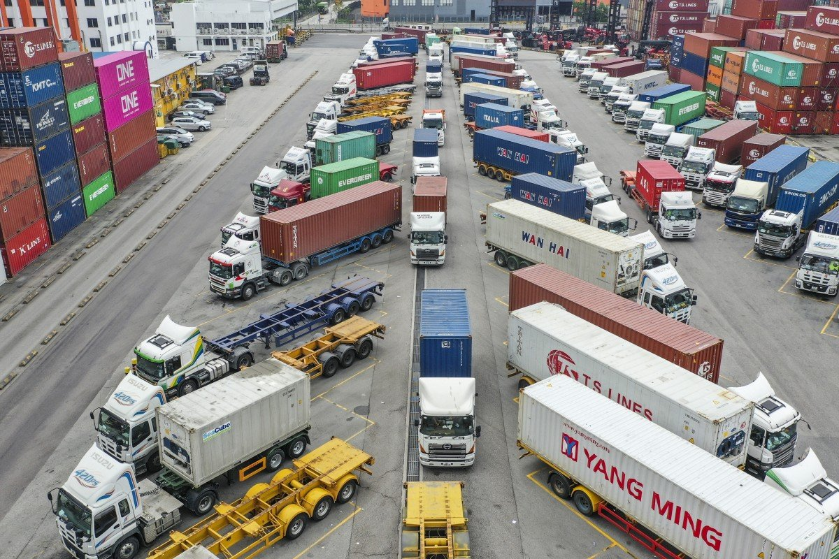 Hong Kong truck drivers working in taxis and firms consider