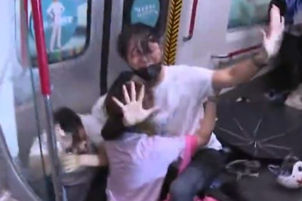 About five officers from the Special Tactical Squad hit four commuters inside an MTR train at Prince Edward station. Photo: TVB
