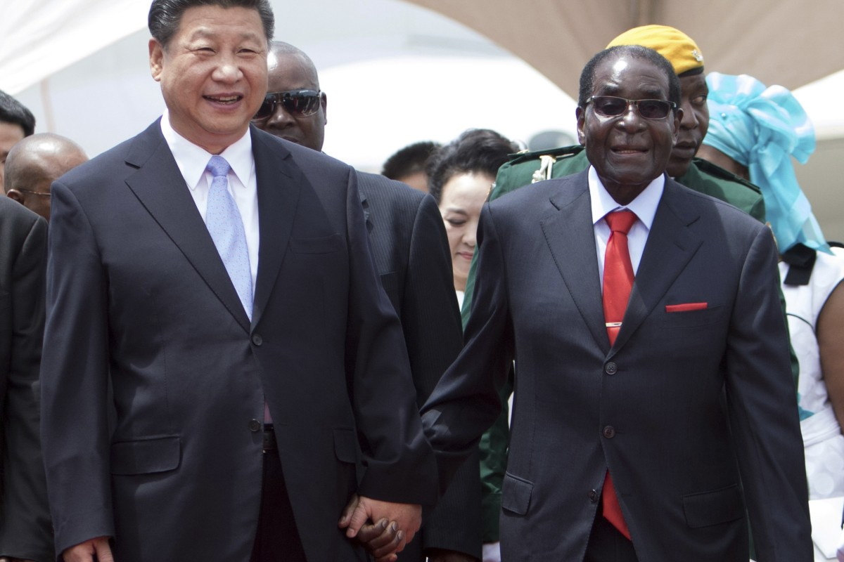 Chinese President Xi Jinping walks hand in hand with then-leader of Zimbabwe, Robert Mugabe, in Harare in 2015. Photo: AFP