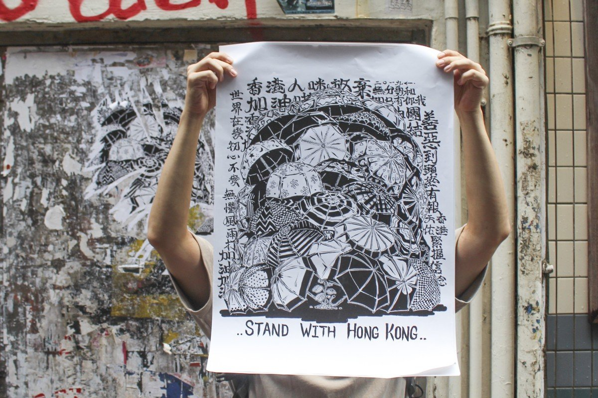 Graffiti artist Boms with his protest poster in a street in Mong Kok. Photo: Snow Xia