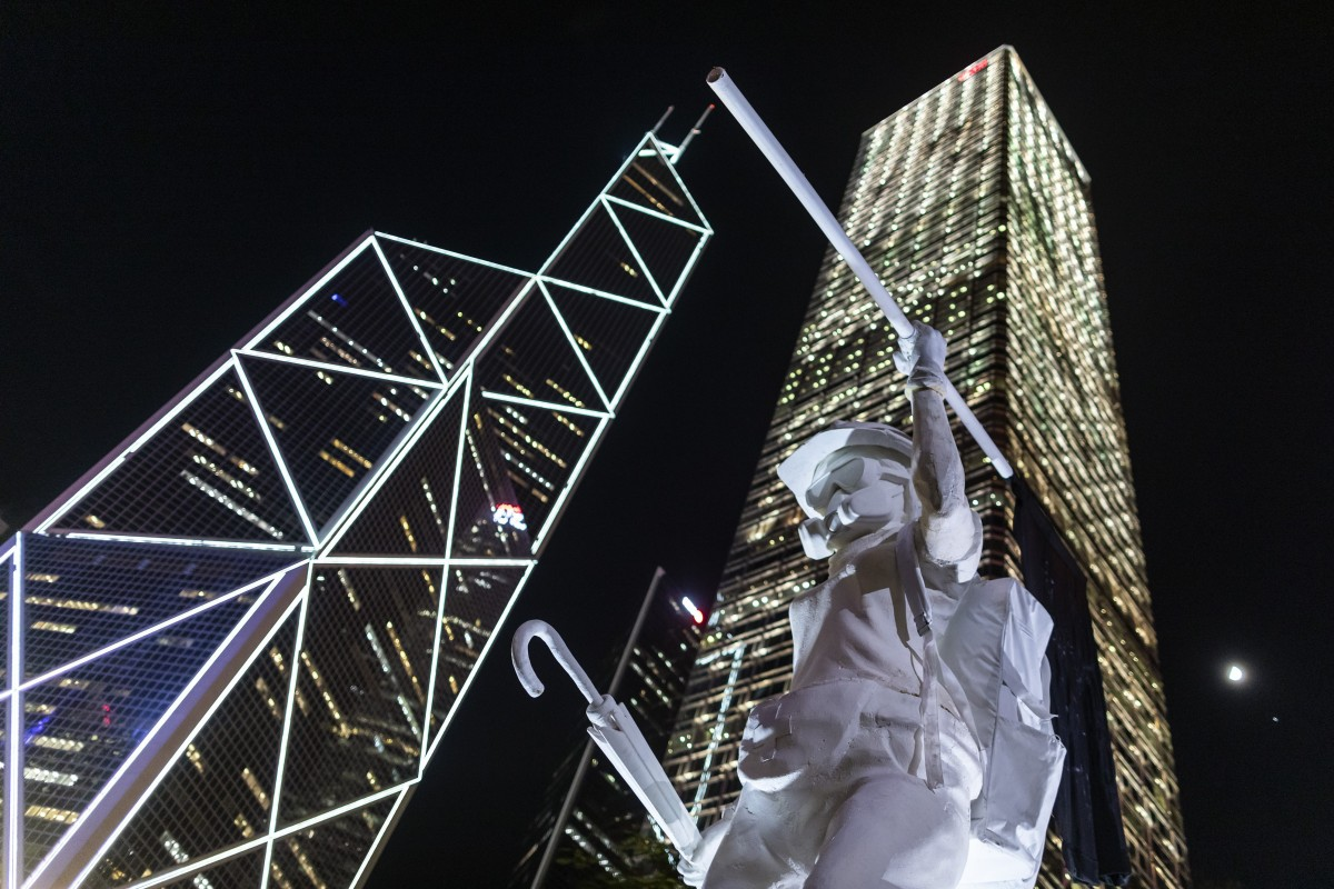 """Hong Kong's """"Lady Liberty"""" statue stands in front of the Bank of China Tower (left) and Cheung Kong Center during a rally at Chater Garden in Central on September 6. Photo: Bloomberg"""