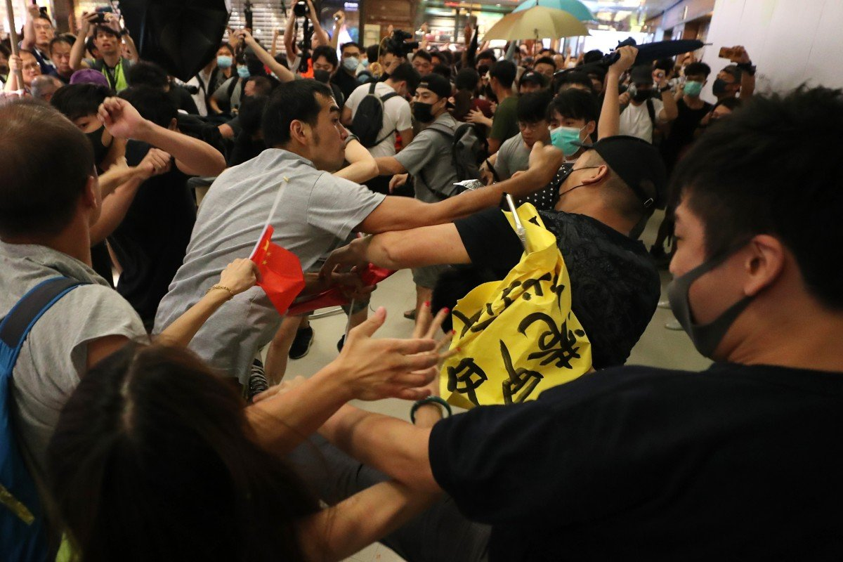 Hong Kong protests: skirmishes and fist fights across the city as rival camps clash but day passes without...