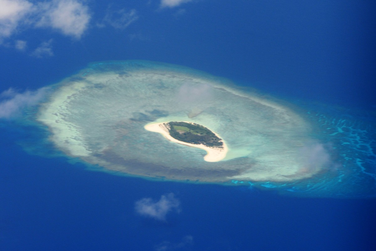 How will Malaysia and China's maritime consultation mechanism affect the South China Sea dispute?