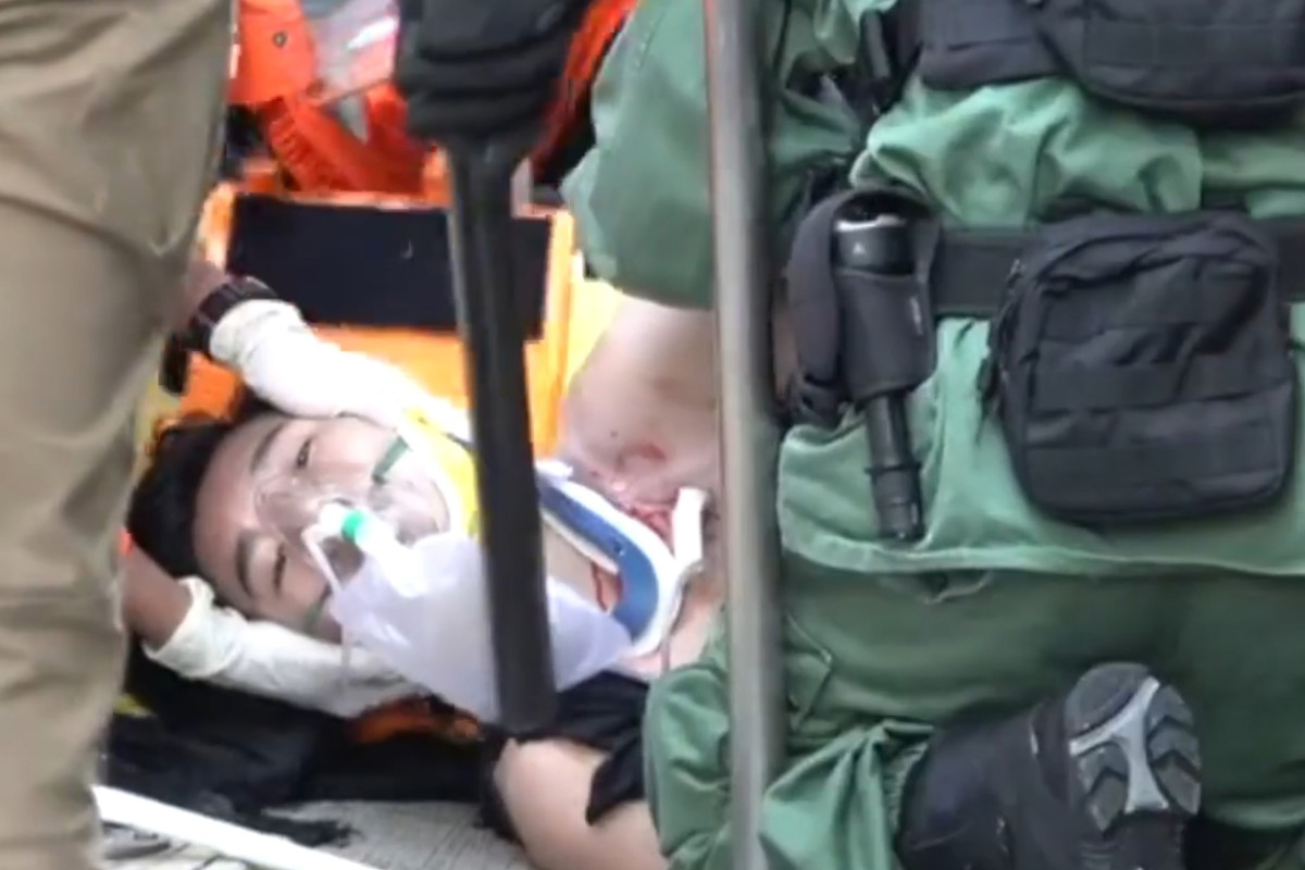 A screen capture from Stand News footage shows the teen being treated for his wound.