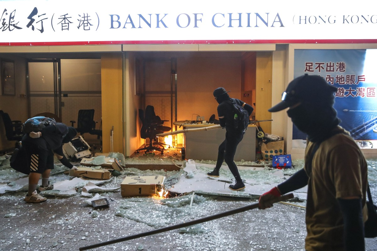 Protesters set a Bank of China branch on fire in Tsuen Wan. Photo: Winson Wong