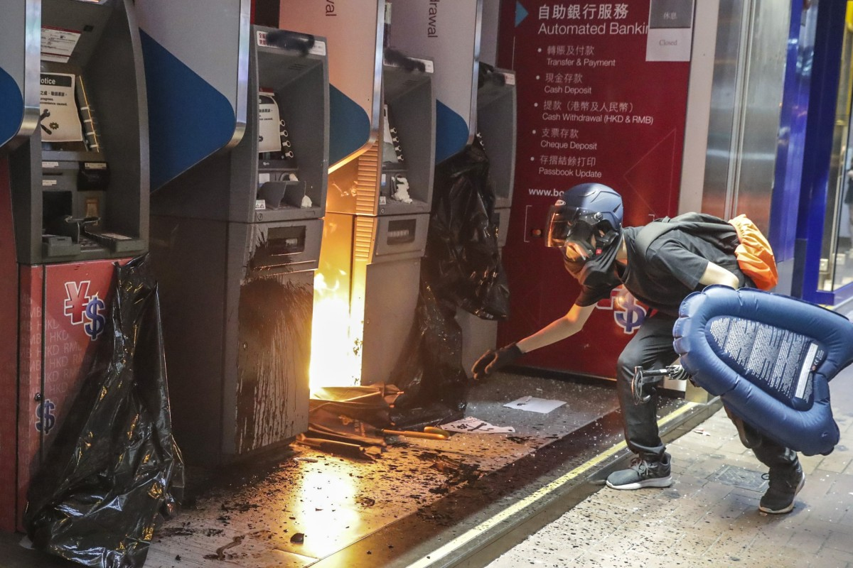 Hong Kong protesters go on yet another rampage, attacking police, meting out mob justice and trashing train...