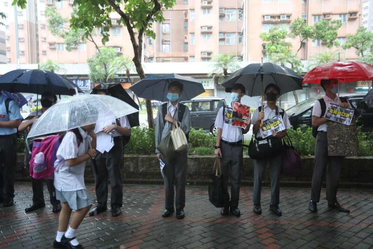 Protesters accuse Hong Kong school of 'suppressing students' with black face mask ban