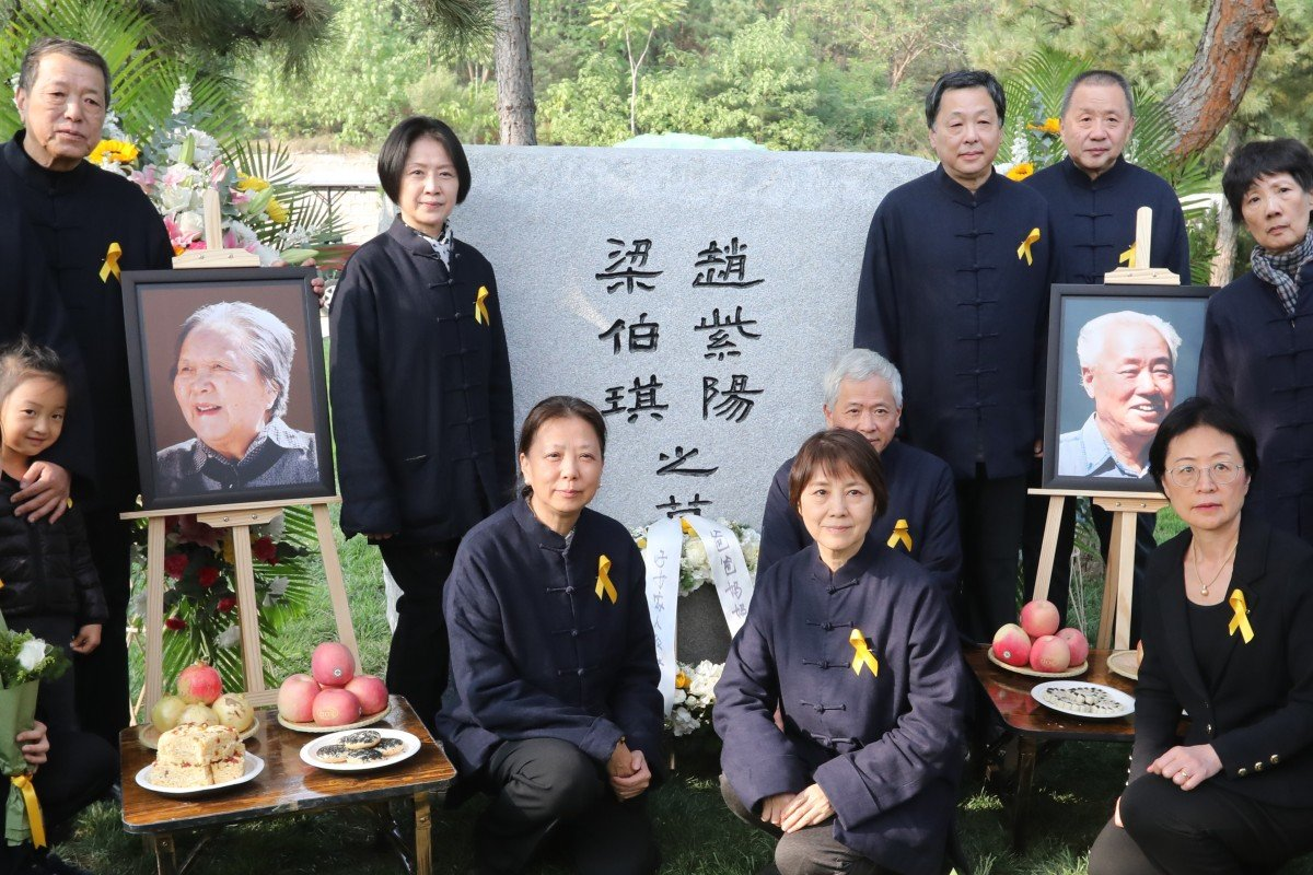 The family of Zhao Ziyang and his wife Liang Boqi pay their respects at the grave where their ashes were interred on Friday. Photo: Simon Song