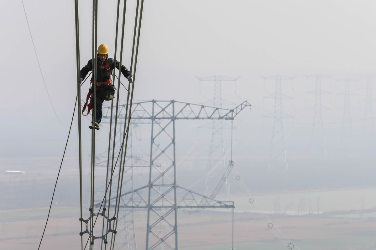 A technician examines the transmission line on an ultra-high voltage system in Huaian, Jiangsu province, in 2015. State Grid's internet technologies project is another part of its plan to upgrade China's power infrastructure. Photo: Xinhua