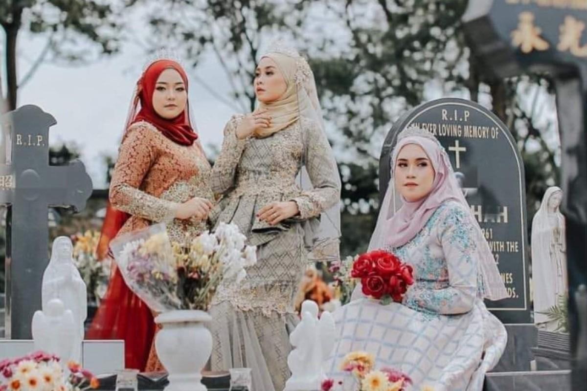 Malaysian photo shoot at Christian cemetery provokes