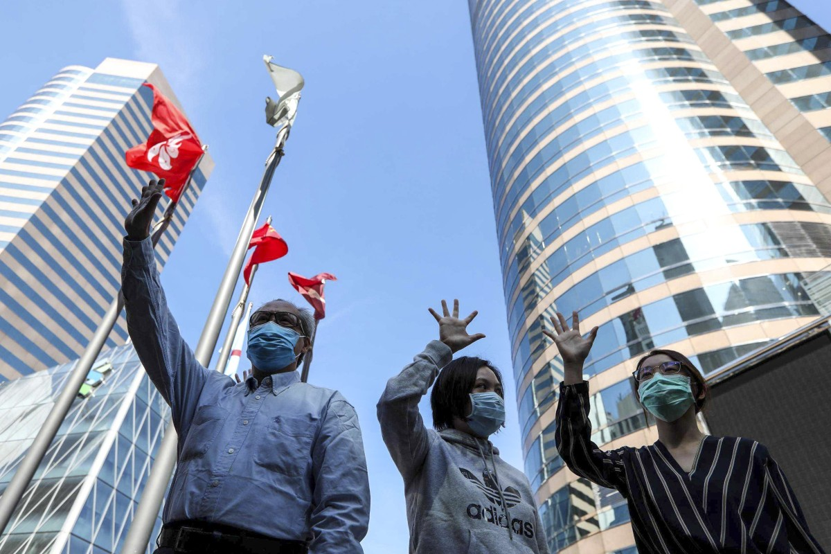 Hong Kong protesters and pro-police group clash during lunchtime demonstration in Central