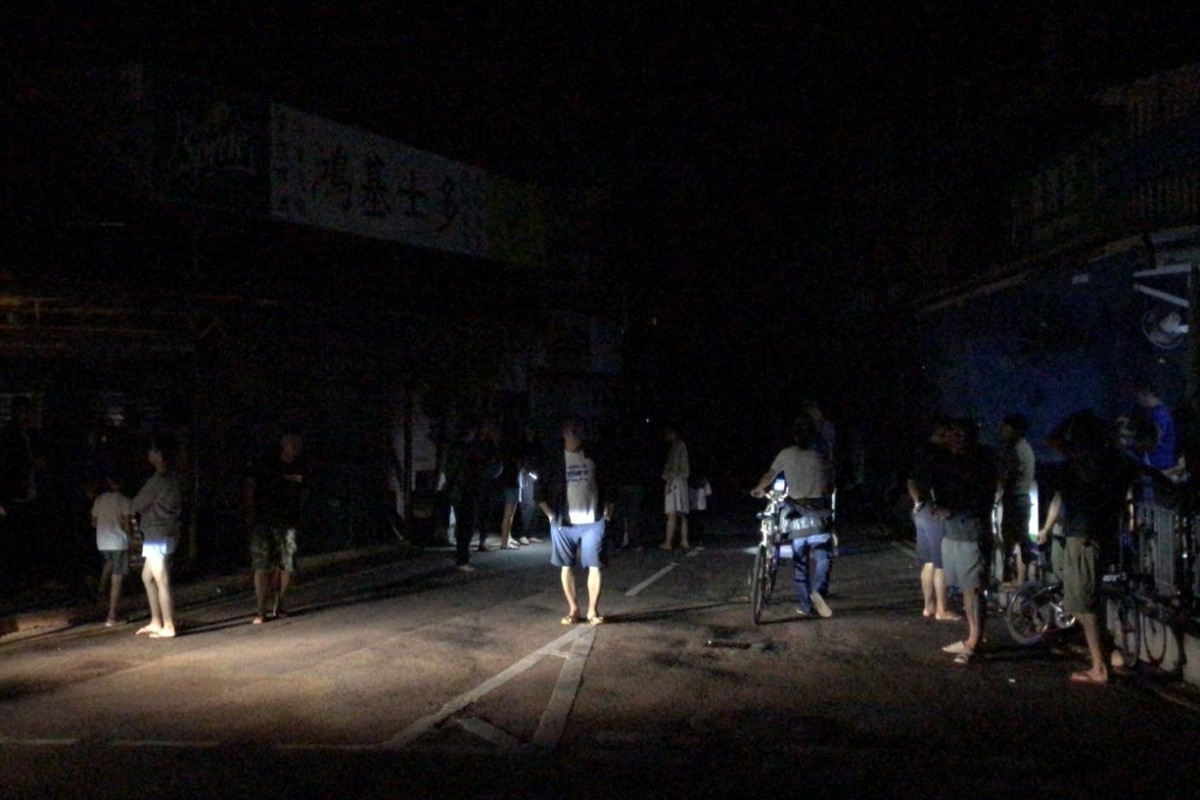 Residents in the dark amid the blackout in Shek O. Photo: Amanda Johnstone