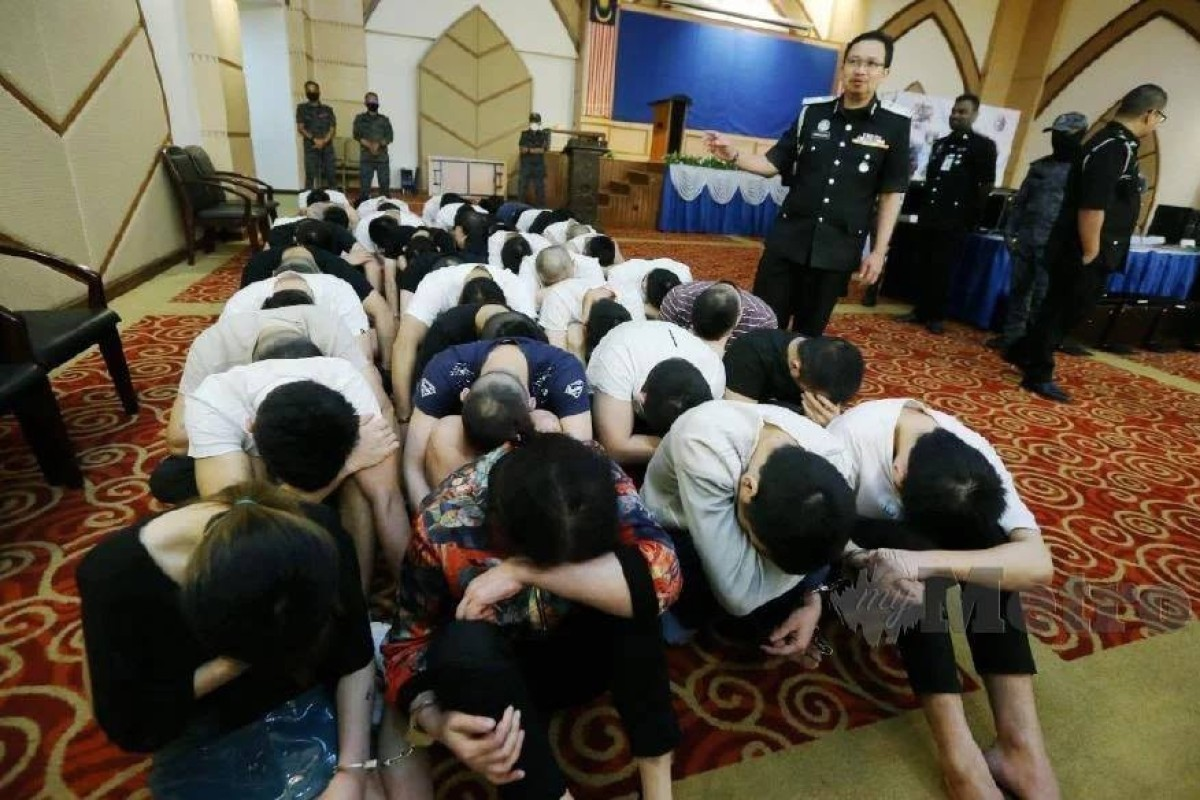 Arrested Chinese suspects after the bust in Ipoh. Photo: Immigration Department of Malaysia