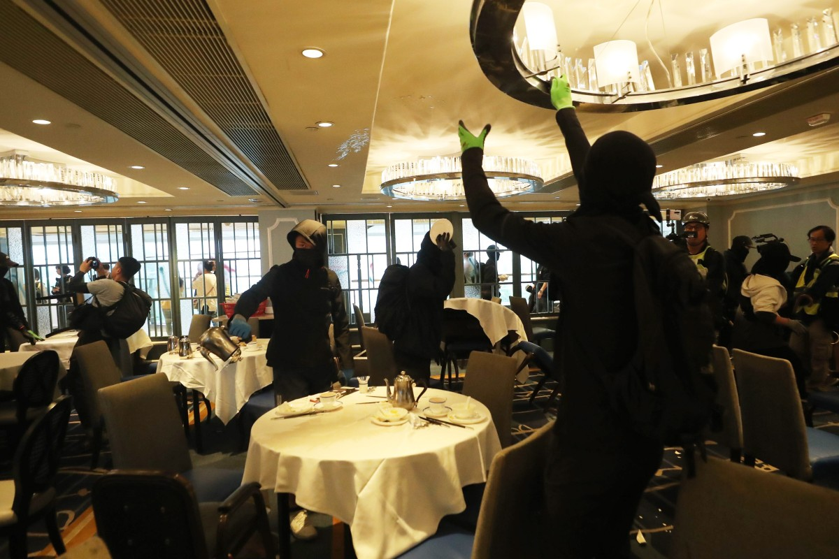 Hong Kong protests: restaurants spray-painted and diners harassed in 'Christmas shopping' action in leading...
