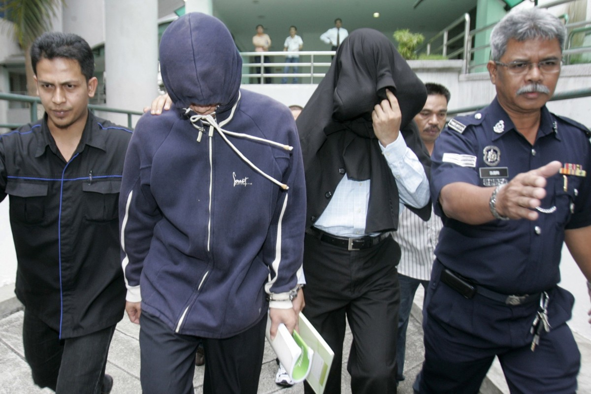 Policemen Azilah Hadri and Sirul Azhar Umar arrive at court. In 2009 both were convicted and sentenced to death. Photo: Reuters