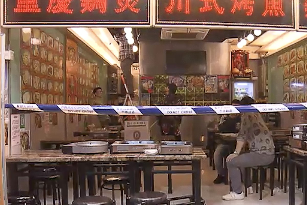 Police are looking for two masked men following a firebomb attack in Sham Shui Po. Photo: Now TV