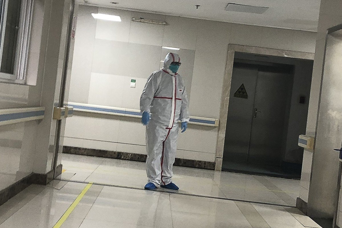 A doctor in full protective gear at the Wuhan Medical Treatment Centre. Photo: Simon Song