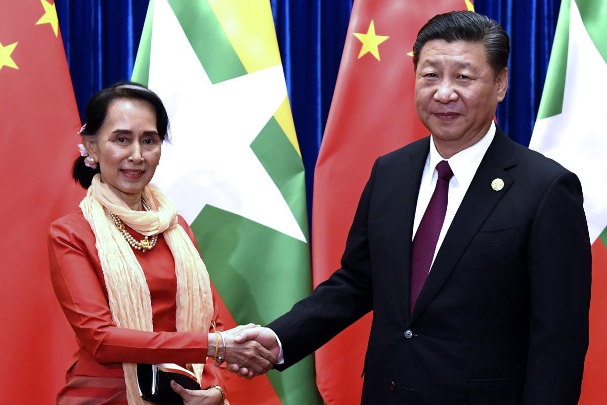 Aung San Suu Kyi meets Xi Jinping during a summit in Beijing in 2017. Xi will visit Myanmar next week. Photo: AP