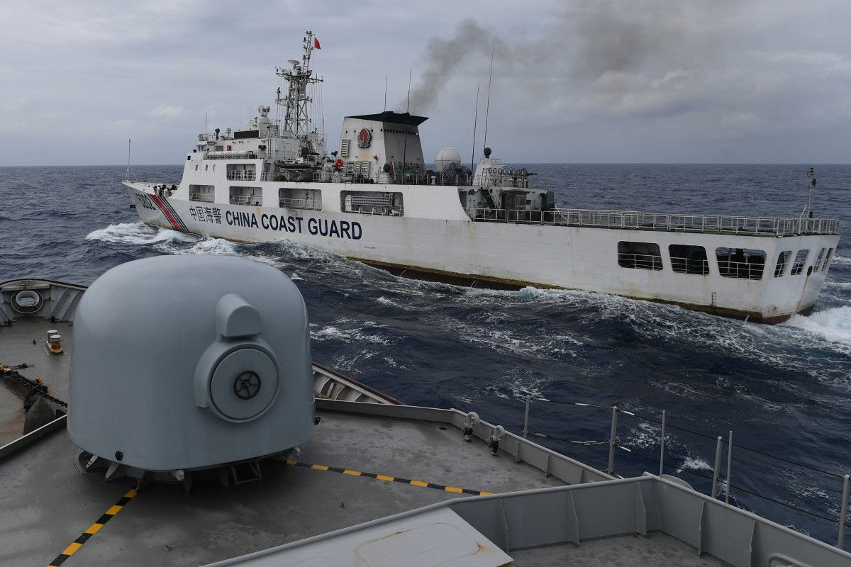 A China Coast Guard ship is seen from an Indonesian naval ship during a patrol in Indonesia's exclusive economic zone north of Natuna island on January 11. Photo: Reuters