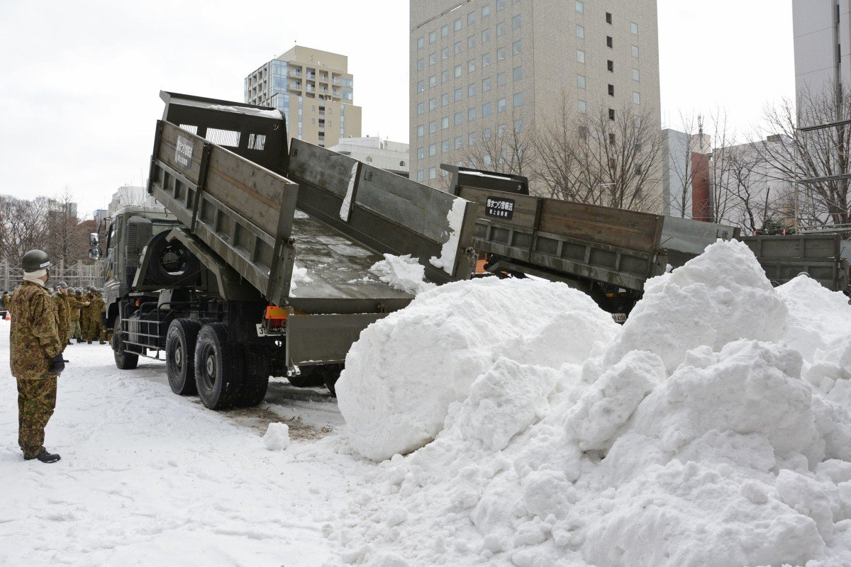 The city of Sapporo has ordered trucks to carry in snow for its annual festival due to reduced snowfall. Photo: Kyodo