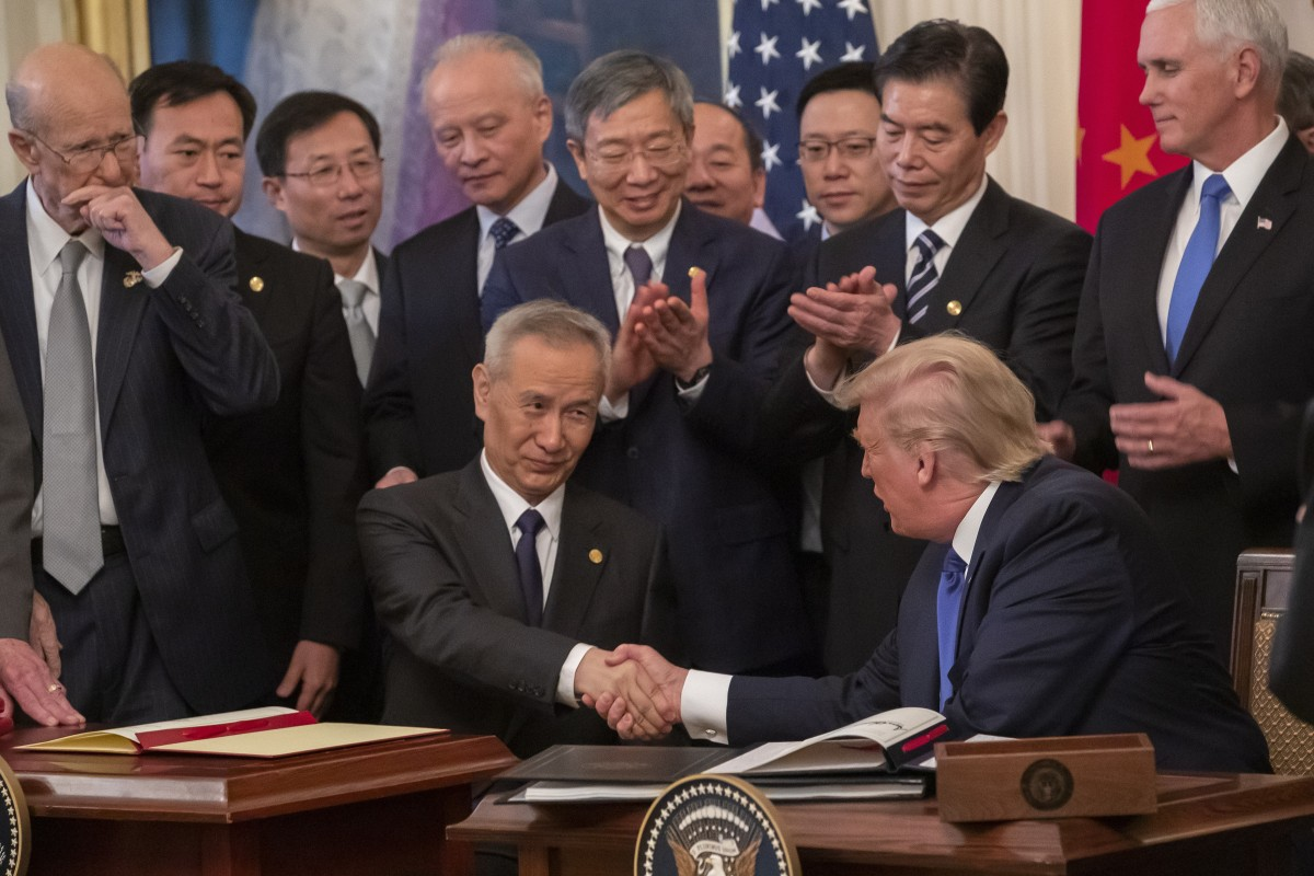 Inside the White House on Wednesday, Chinese Vice-Premier Liu He and US President Donald Trump took part in the signing ceremony for a trade agreement. Outside the White House, a variety of Chinese protesters hoped to draw attention to their issues. Photo EPA-EFE