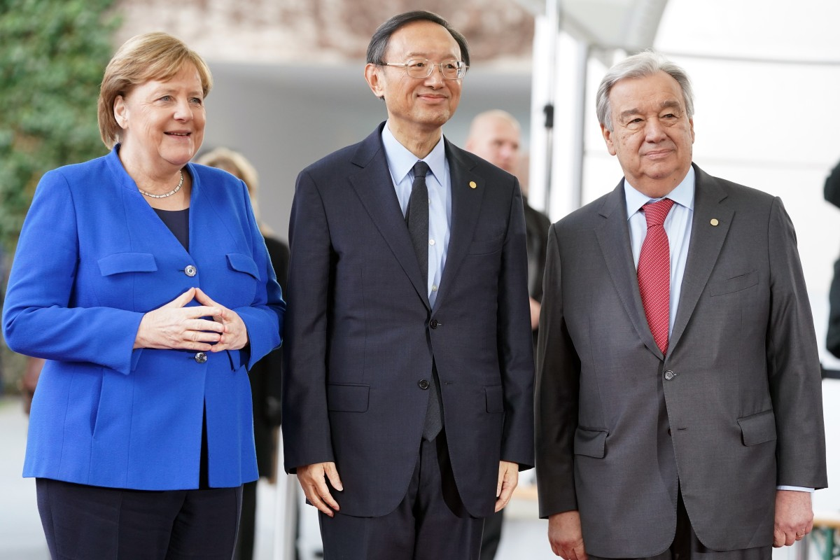 Yang Jiechi (centre) joins leaders including German Chancellor Angela Merkel and UN Secretary General Antonio Guterres at a conference on Libya in Berlin on Sunday. Photo: DPA