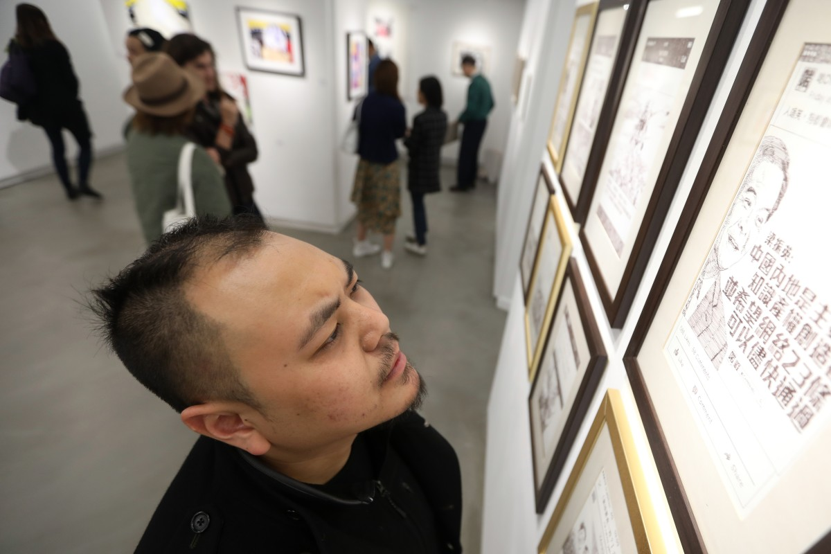 Artist Chow Chun-fai with one of his works at the opening of the 'What's On Paper' exhibition, at Hong Kong Visual Arts Centre, in December. Photo: Xiaomei Chen