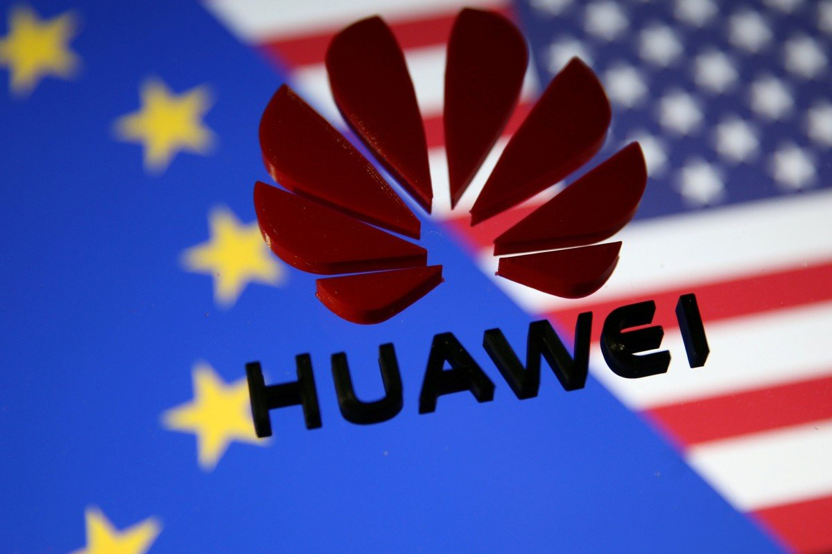 A 3D printed Huawei logo is placed on glass above displayed EU and US flags in this illustration taken January 29, 2019. Photo: Reuters