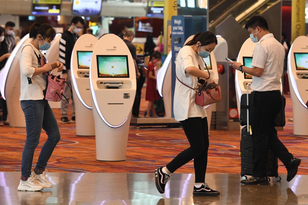 Travellers wearing face masks at Changi International Airport in Singapore. Photo: AFP