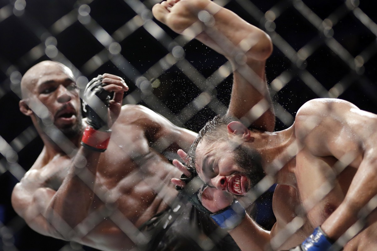 Jon Jones delivers a kick to Dominick Reyes at UFC 247. Photo: AP
