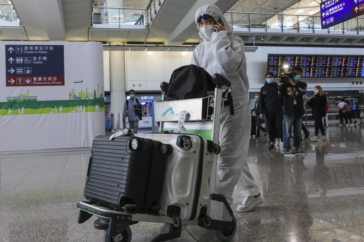 A traveller takes anti-infection precautions at Hong Kong International Airport. Photo: K.Y. Cheng