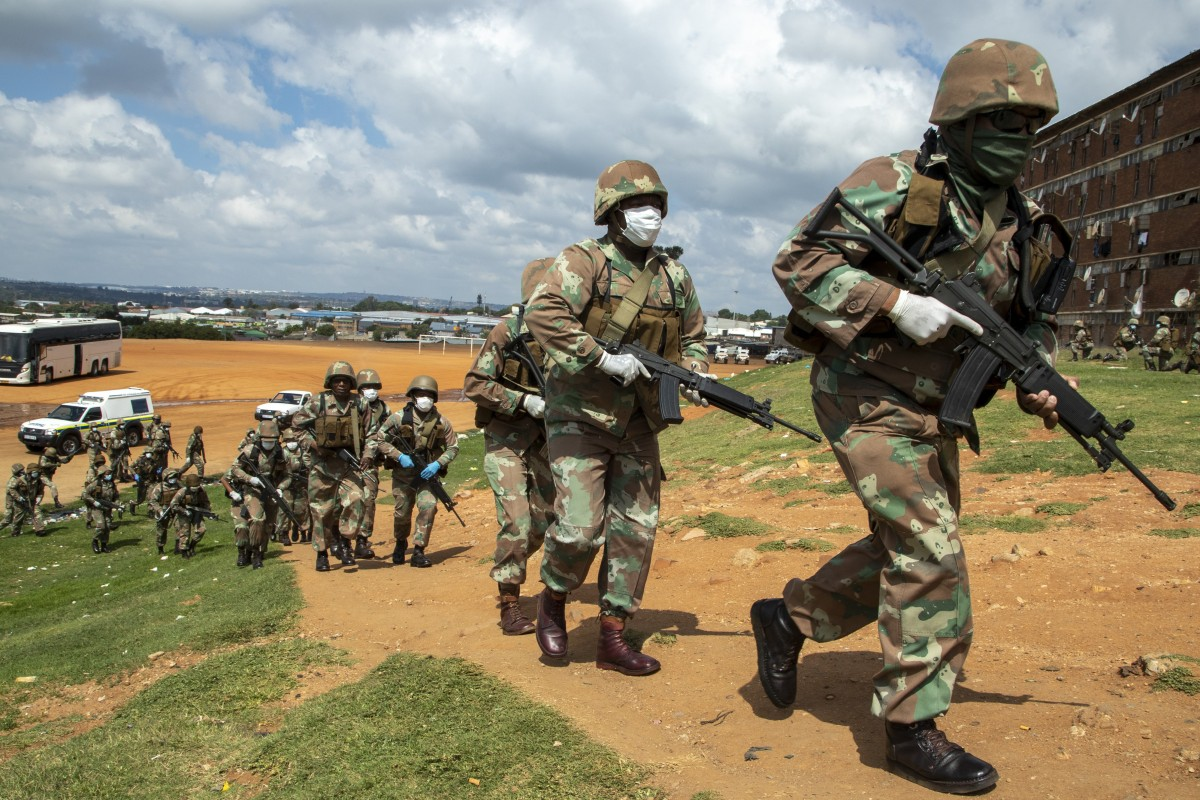 South African National Defence Forces pictured enforcing the country's coronavirus lockdown in Johannesburg on Saturday. Photo: AP