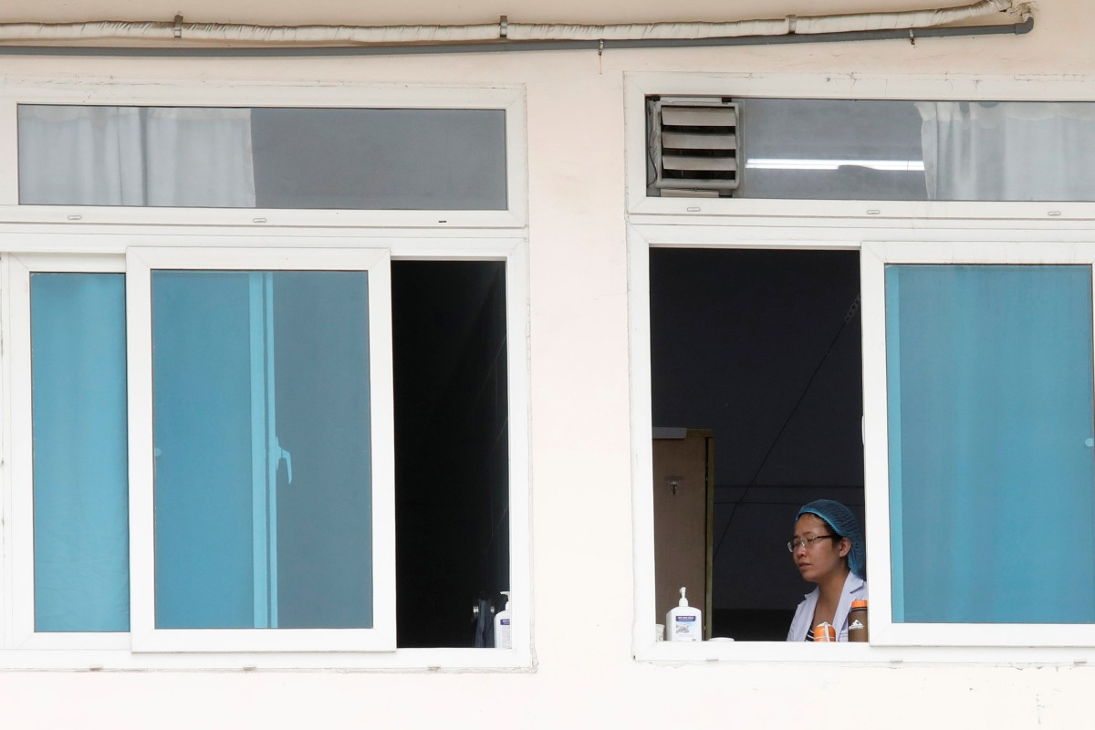 A health worker at one of Vietnam's largest hospitals, Bach Mai, in Hanoi. Photo: Reuters
