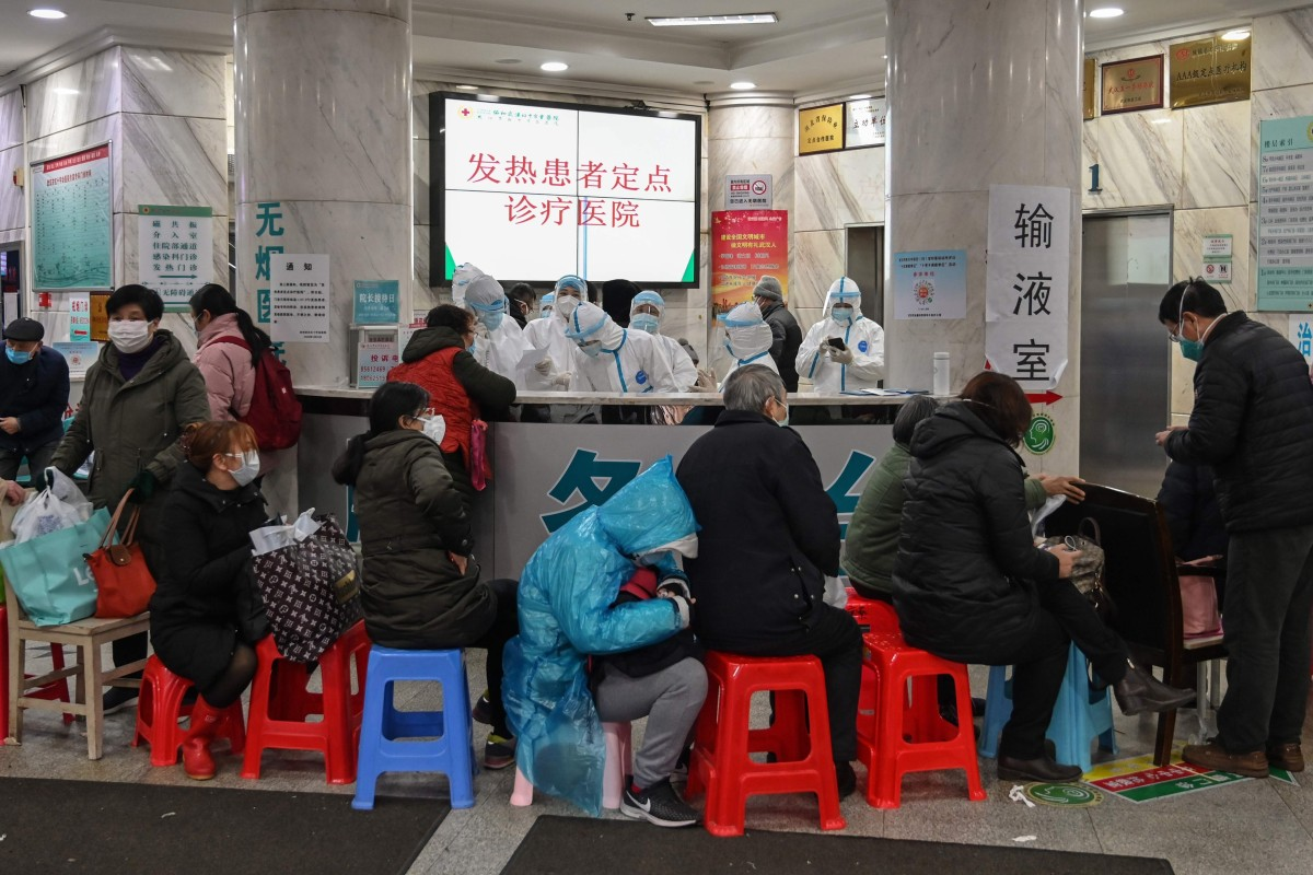 Medical staff in protective clothing try to cope with an influx of patients Wuhan Red Cross Hospital in the early days of the coronavirus epidemic. Photo: AFP