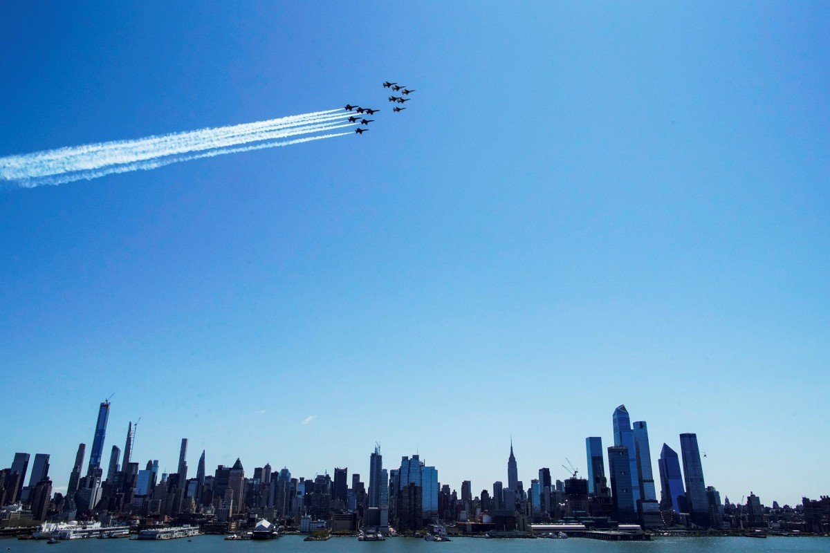 US Navy Blue Angels and US Air Force Thunderbirds demonstration perform a flyover in New York to honour first responders and essential workers. Photo: Reuters