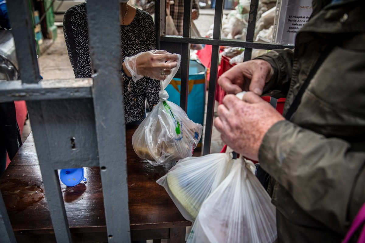 Volunteers hand out food aid parcels from a distribution point at the Santa Anna church in Barcelona, Spain, on May 17. The European Commission has forecast that the EU would see a 7.4 per cent economic contraction this year, the worst recession in its history. Photo: Bloomberg