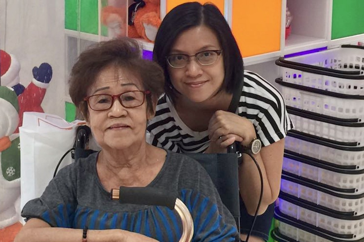 Loh Yok Hing (left), who has mild to moderate dementia and is wheelchair-bound, with her daughter and carer Cindy Teo in Singapore. As the pandemic continues, it is not uncommon for elderly people to feel lonely, anxious and stressed. Photo: Cindy Teo
