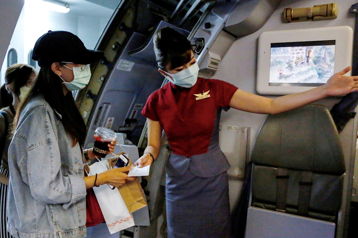 "Would-be tourists take part in a ""fake"" travel experience for tourists at Songshan airport in Taipei on Thursday. Photo: Reuters"