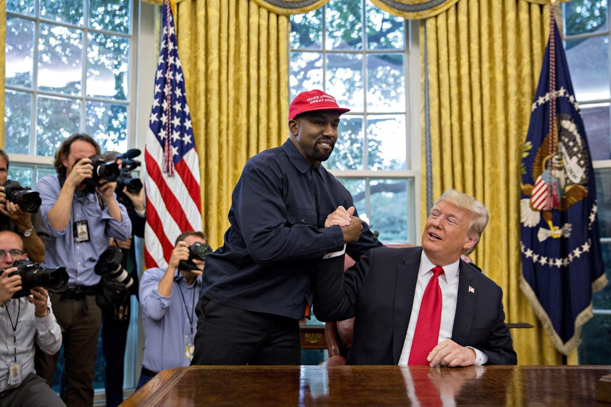 Rapper Kanye West (left) shakes hands with US President Donald Trump during a meeting in the Oval Office of the White House in Washington on October 11, 2018. Photo: Bloomberg