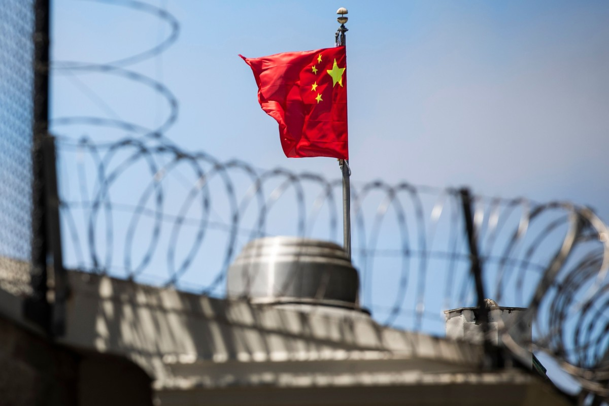 The Chinese flag flies behind barbed wire at the Chinese Consulate General in San Francisco. Photo: AFP