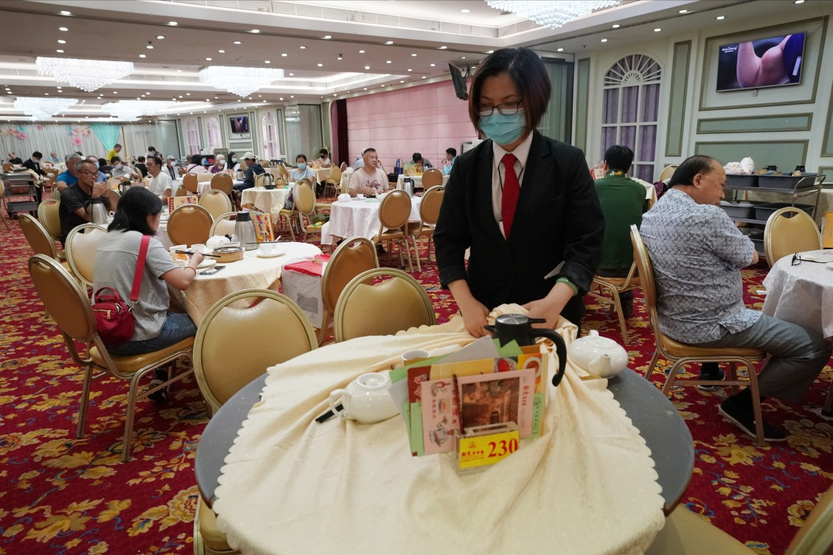 A staff member clears a table at a restaurant in Aberdeen on July 28. Some studies suggest social distancing at less than 2 metres can still be safe, raising hopes restaurants and other indoor venues can remain open for business during the pandemic. Photo: Felix Wong
